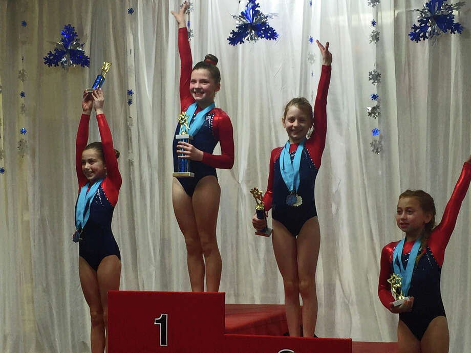 Darien YMCA Level 4 Gymnasts swept the All-Around podium in the 8-9 age group at the Wilton Snowflake Invitational. L-R, Ali Kolman, third: Lauren Smith, first; Alexia Buchesky, second; and Julia Decsi, fourth. Photo: Contributed / Darien News