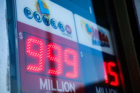 A sign advertising the Powerball lottery is seen outside Miraloma Market in San Francisco, California on Wednesday, January 13, 2016. The sign reads 999 million, although it is actually 1.5 billion dollars.