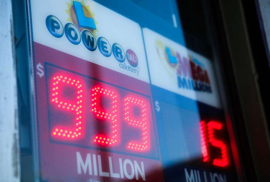 A sign advertising the Powerball lottery is seen outside Miraloma Market in San Francisco, California on Wednesday, January 13, 2016. The sign reads 999 million, although it is actually 1.5 billion dollars. Photo: Gabrielle Lurie, Special To The Chronicle