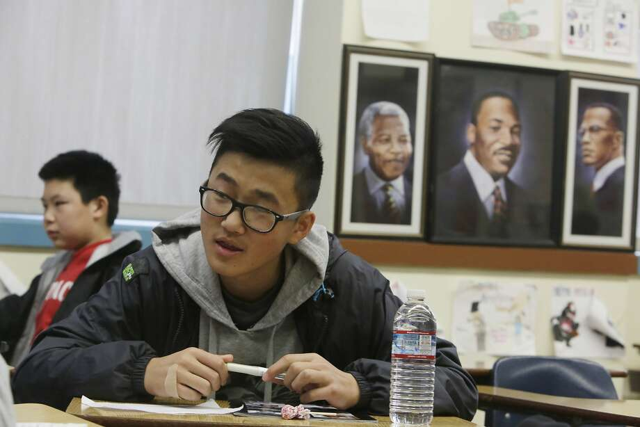 Freshman David Chen (right) sits next to portraits of  Nelson Mandela, Martin Luther King, Jr and Malcolm X while working with classmates on a class assignment during ethnic studies class at Washington High School on Wednesday, January 13, 2015 in San Francisco, Calif. Photo: Lea Suzuki, The Chronicle