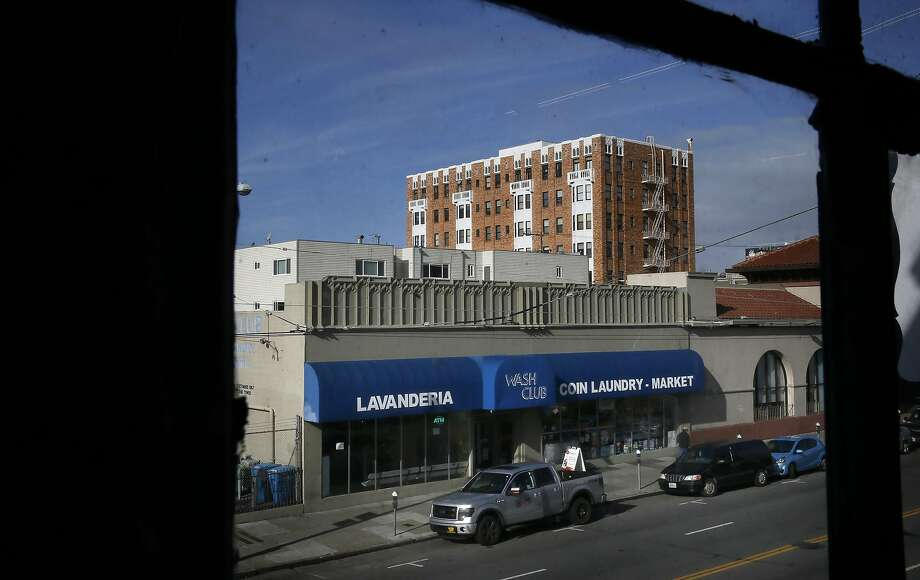 Robert Tillman the owner of the building at 2318 Mission St. that has a laundromat and market, in San Francisco, Calif.,  on Wed. January 13, 2016, would like to develop the property into housing units. The project has been delayed yet again. Photo: Michael Macor, The Chronicle