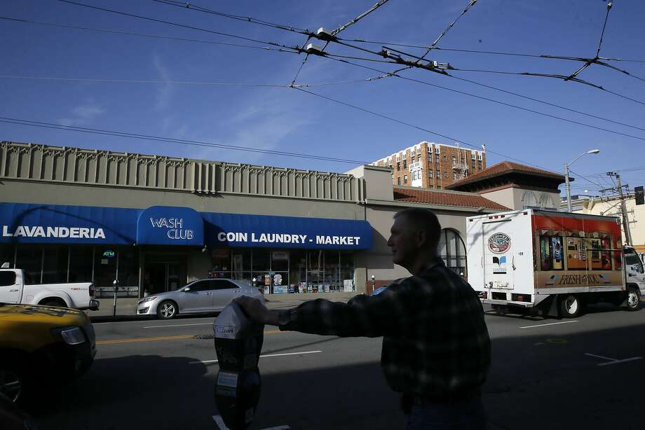 Robert Tillman across the street from the laundromat he owns at 2318 Mission St. in San Francisco, Calif., on Wed. January 13, 2016. Tillman would like to develop the property into housing units. Photo: Michael Macor, The Chronicle