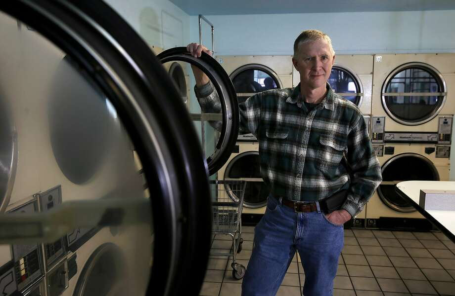 Robert Tillman inside the laundromat he owns at 2318 Mission St. in San Francisco, Calif., on Wed. January 13, 2016. Tillman would like to develop the property into housing units. Photo: Michael Macor, The Chronicle