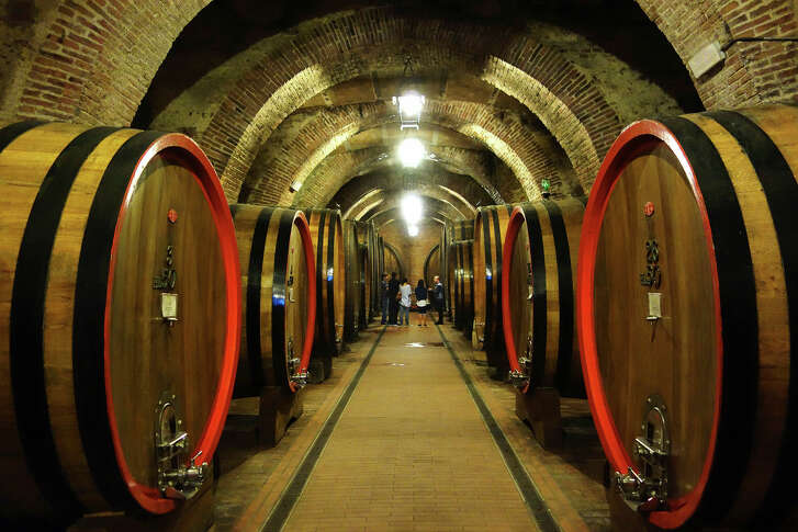 In Montepulciano, huge casks hold raw wine for at least a year so that the wine can pick up the personality of the wood as it ages.