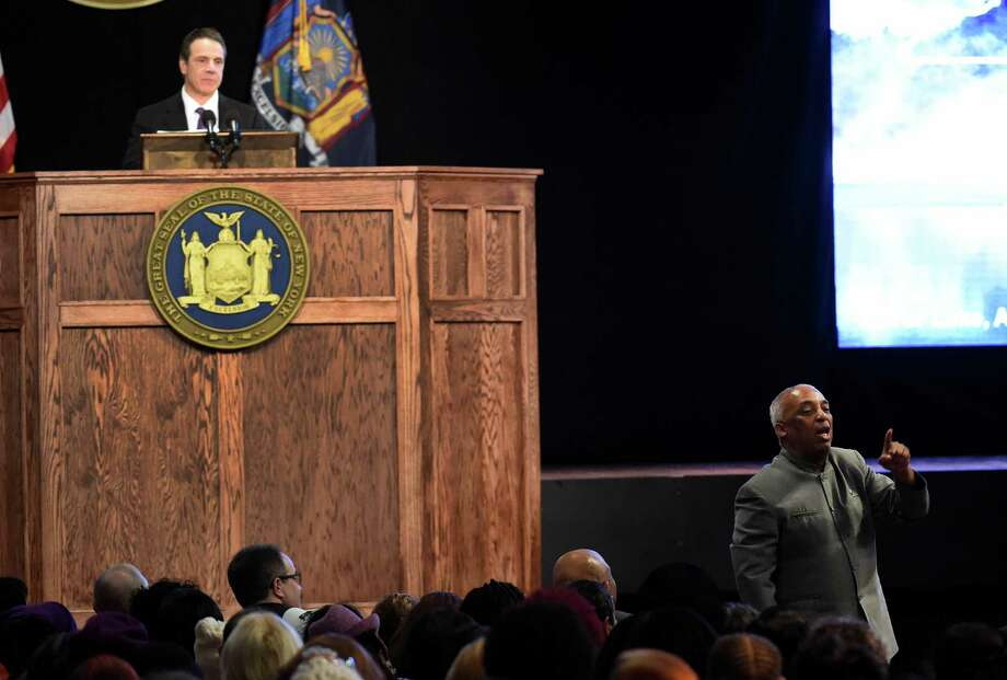 Assemblyman Charles Barron of the 60th AD, right, voices his opinion during Gov. Andrew Cuomo's presentation of the State of the State message at the Convention Center at the Empire Plaza Wednesday, Jan. 13, 2015, in Albany, N.Y.    (Skip Dickstein/Times Union) Photo: SKIP DICKSTEIN / 10034976A