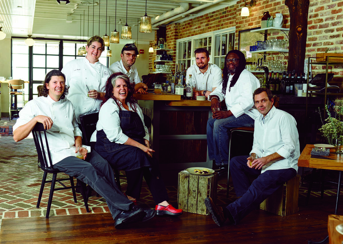 """The February/March issue of Garden & Gun magazine features """"The Southern Hot List"""" of Southern talent. The spread includes an article about enterprising Southern chefs that includes Houston's PJ Stoops of the new Foreign Correspondents northern Thai restaurant. From left: Joseph Lenn, Kelly Fields, Lisa White, Elliott Moss, Jeremiah Langhorne, Matthew Raiford, and P. J. Stoops, photographed at the Dabney in Washington, D.C. (By William Hereford)"""