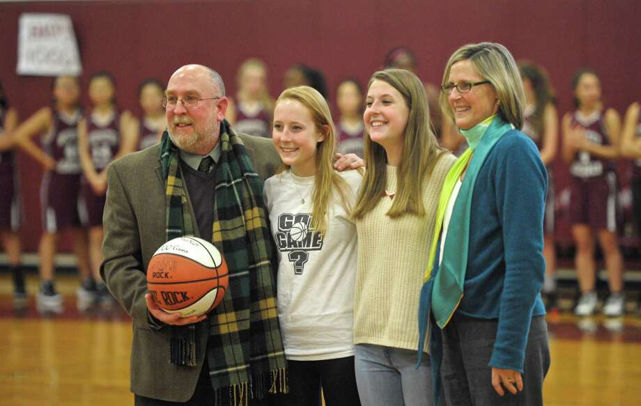 Wooster School girls varsity basketball coach David McNutt was presented a game ball celebrating his 1,000th career varsity basketball game on Wednesday afternoon. Celebrating with him were his his daughters Jamie and Kate McNutt, and wife Janet Jochem, right. With a career record of 780-220, with todays victory, McNutt, who started teaching and coaching at Wooster in 1992, led the Wooster Generals girls varsity basketball team to 22 New England Tournaments, 16 league titles, 6 undefeated seasons and the New England Class E Championship the last two seasons. Wednesday, January 13, 2016, in Danbury, Conn. Photo: H John Voorhees III / Hearst Connecticut Media / The News-Times