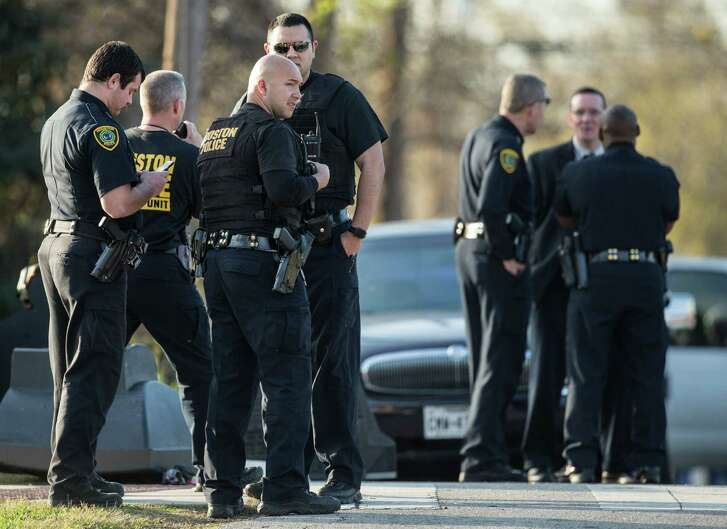 Police investigate the scene where a Houston Police officer was shot in the 3100 block of Anita on Wednesday, Jan. 13, 2016, in Houston.