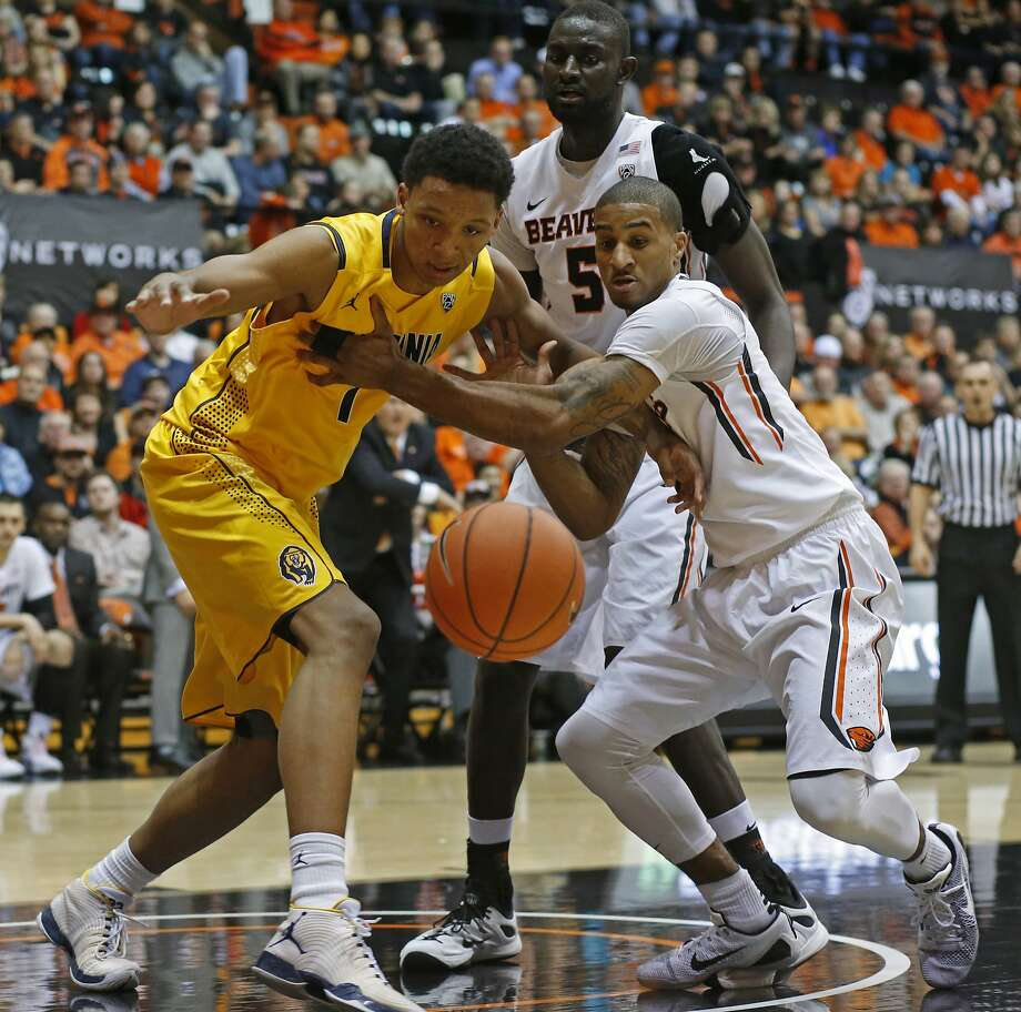California's Ivan Rabb, left, and Oregon State's Gary Payton II go after a loose ball during the first half of an NCAA college basketball game in Corvallis, Ore., on Saturday, Jan. 9, 2016. (AP Photo/Timothy J. Gonzalez) Photo: Timothy J. Gonzalez, Associated Press