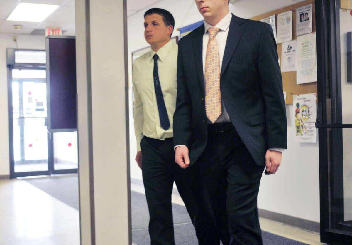 Joshua Rockwood, left, walks back into Glenville Town Court with his lawyer on Monday, April 27, 2015, in Glenville, N.Y. Rockwood, who had his horses seized for alleged neglect, was at court for a hearing on the case. (Paul Buckowski / Times Union)