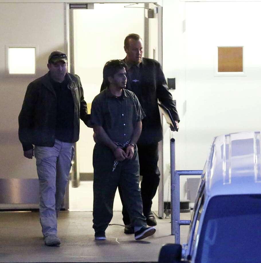 Omar Faraj Saeed Al Hardan is escorted out of the Bob Casey United States Courthouse by U.S. Marshalls Wednesday, Jan. 13, 2016, in Houston. Photo: Jon Shapley, Houston Chronicle / © 2015  Houston Chronicle