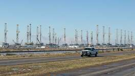 Drilling rigs sit idle in Odessa last year. As low oil prices hammer energy companies and begin trickling into other economic sectors, analysts expect further stress in banks' energy portfolios.