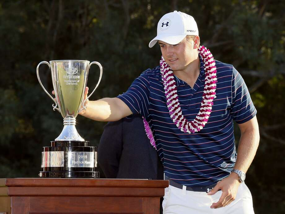 Jordan Spieth's trophy at the Tournament of Champions on Sunday was Spieth's seventh on the PGA Tour before reaching age 23, matching Tiger Woods. Spieth turns 23 in July. Photo: Matt York, Associated Press