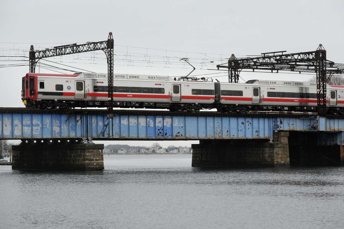 A Metro-North train crosses the Saugatuck River bridge, in Westport.