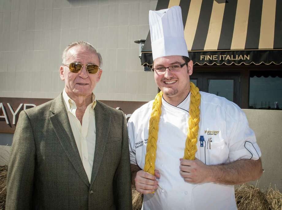 Apollo 7 astronaut Walter Cunningham, left, took part in the Nov. 9 opening of Maggiano's Little Italy, an Italian-American restaurant located in Baybrook Mall at 700 Baybrook Mall Drive. Cunningham is pictured with the restaurant's executive chef, Philippe Verain. Photo: Maggiano's Little Italy