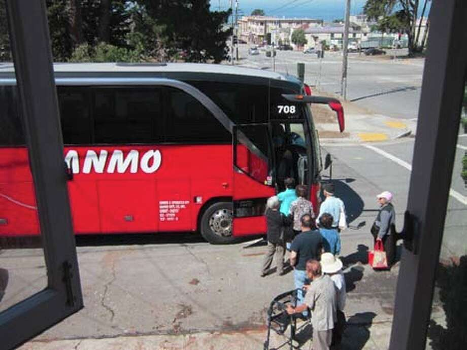 Riders board a casino bus outside of a home on 36th Avenue and Noriega Street, in this photo provided by Supervisor Katy Tang's office.