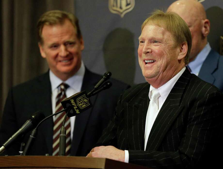 NFL Commissioner Roger Goodell, left, laughs as Oakland Raiders owner Mark Davis talks to the media after an NFL owners meeting Tuesday, Jan. 12, 2016, in Houston. The owners voted to allow the St. Louis Rams to move to a new stadium just outside Los Angeles, and the San Diego Chargers will have an option to share the facility.