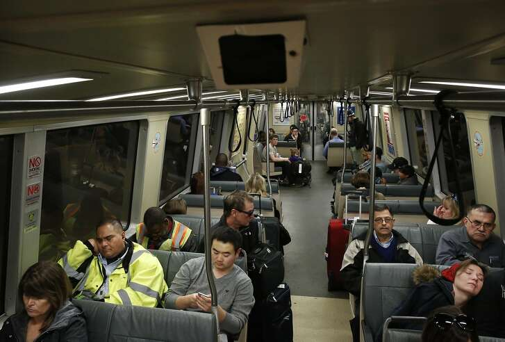 A fake security camera can be seen with a flashing red light as people ride a BART train headed towards Pittsburg/Bay Point station from San Francisco Jan. 13, 2015 near Oakland, Calif.