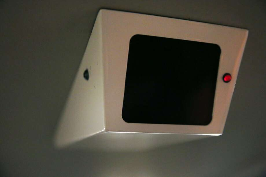 A fake security camera can be seen with a flashing red light as people ride a BART train headed towards Pittsburg/Bay Point station from San Francisco Jan. 13, 2015 near Oakland, Calif. Photo: Leah Millis, The Chronicle