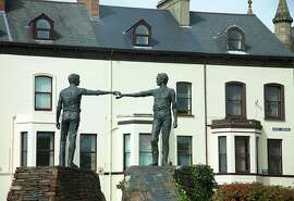 "The sculpture ""Hands across the Divide"" epitomizes Derry's hopes for a peaceful future."