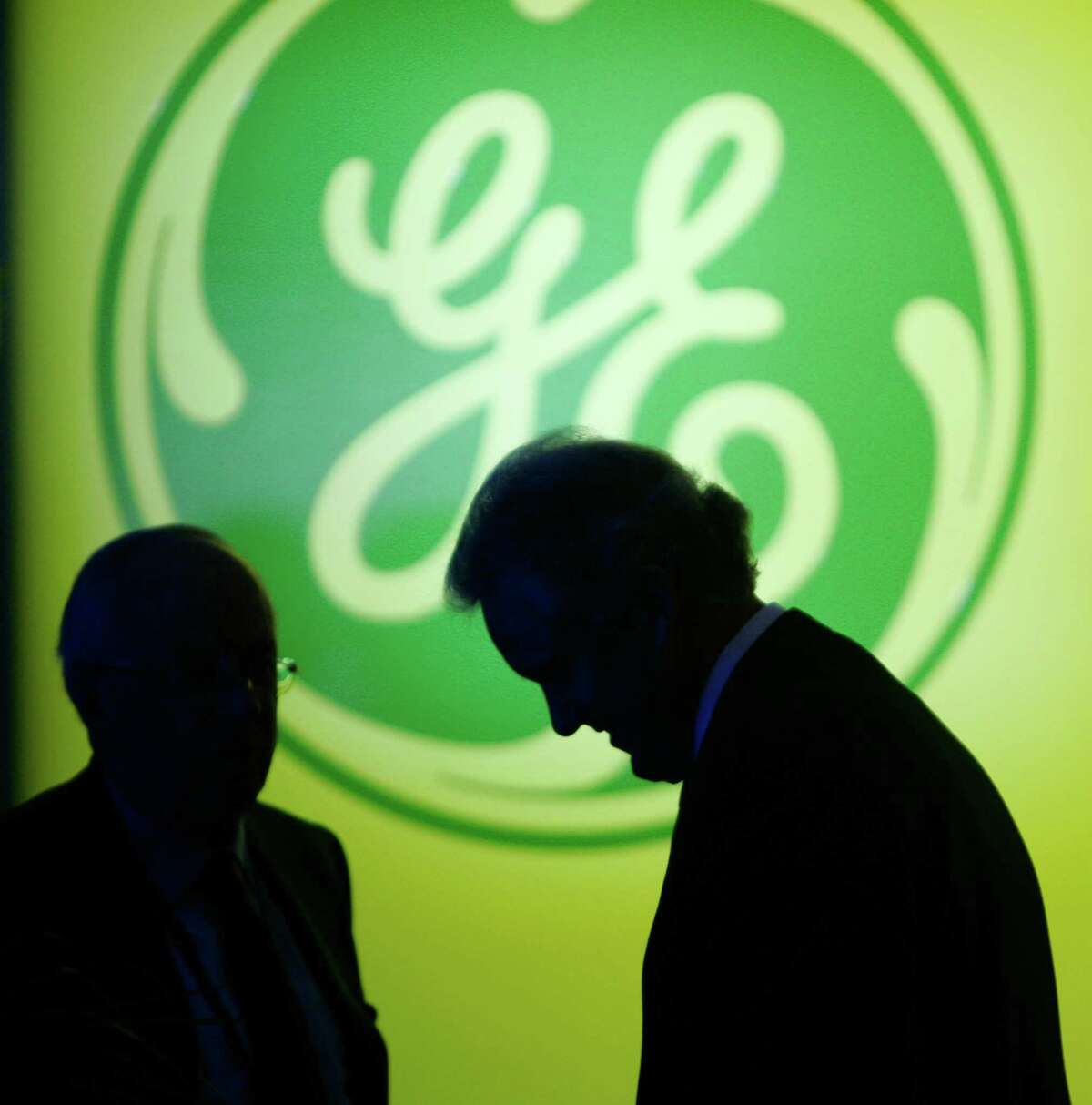 FILE - In this April 23, 2008, file photo, General Electric Co. CEO Jeff Immelt, right, waits for the start of the company's annual shareholders meeting in Erie, Pa. (AP Photo/Tony Dejak, File)