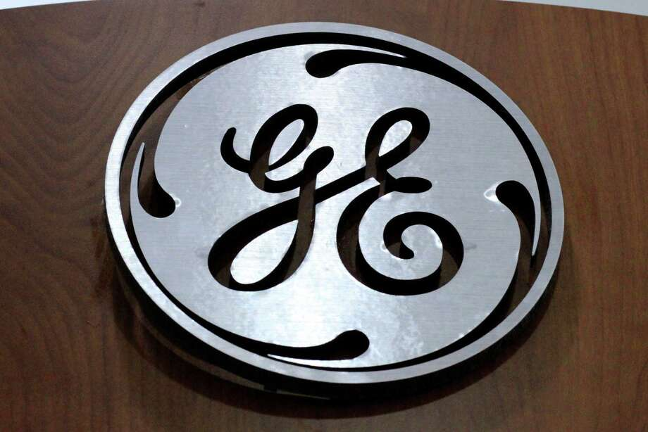 FILE - This Jan. 16, 2014 file photo shows the General Electric logo at a store in Cranberry Township, Pa. General Electric announced Wednesday, Jan. 13, 2016, it will move its headquarters from Fairfield, Conn., to the Seaport District of Boston. (AP Photo/Gene J. Puskar, File) Photo: Gene J. Puskar, STF / AP