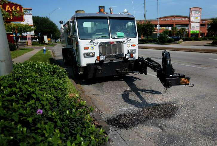 A city of Houston public works pothole truck fills a hole along Hillcroft Avenue near the Westpark Tollway in September. Mayor Sylvester Turner's initiative to repair potholes within 24 hours has a 96 percent success rate so far.
