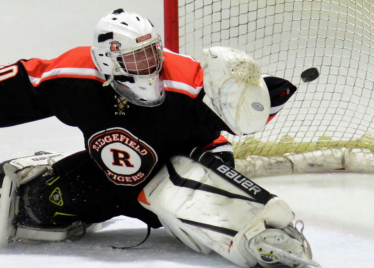 The puck gets past Ridgefield goalie Rian Stewart during boys hockey action against Fairfield Warde/Ludlowe at the Wonderland of Ice in Bridgeport, Conn., on Wednesday Jan. 13, 2016. Fairfield's Jake Fuss scored the goal in this play.