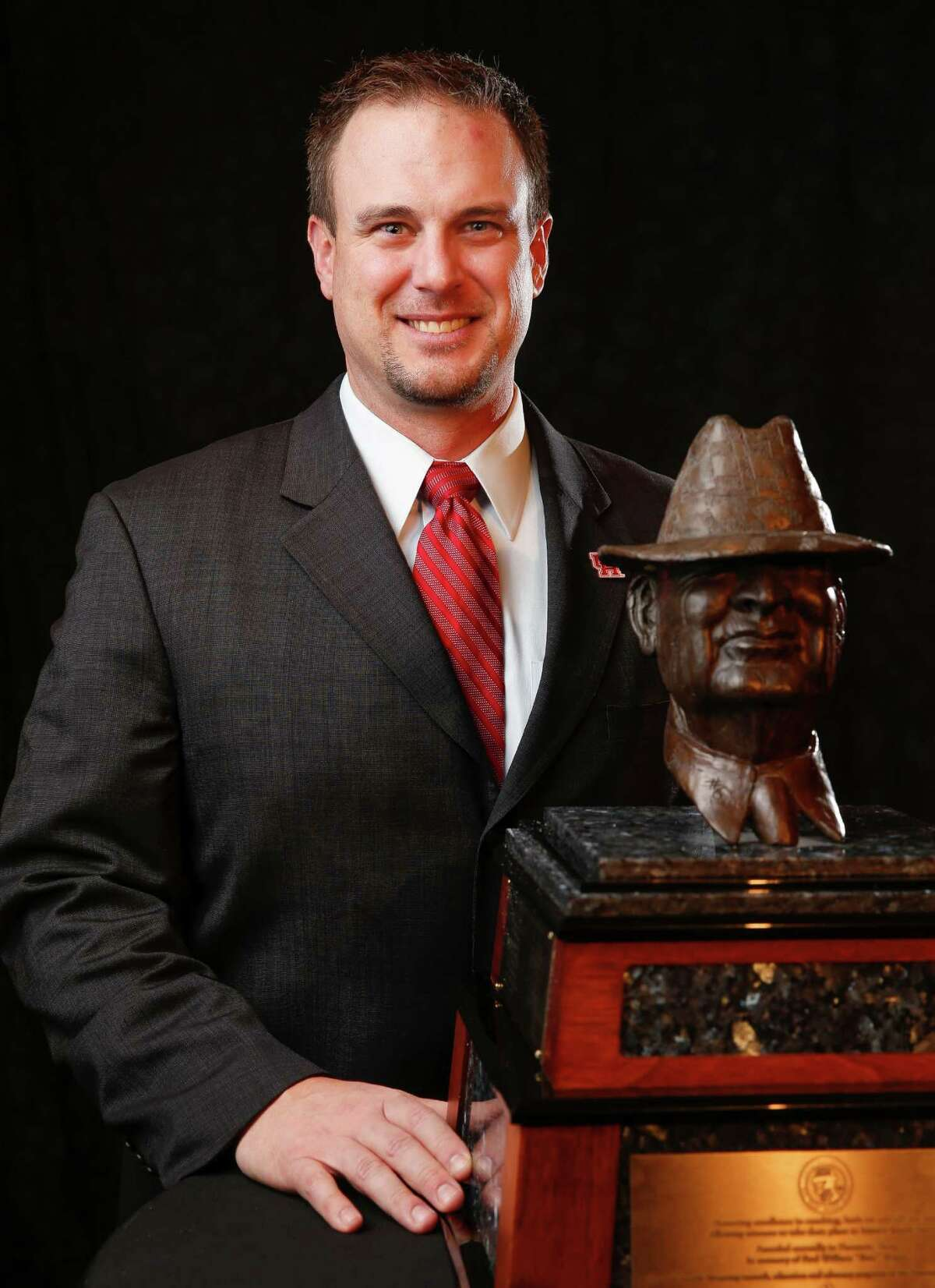 Houston football coach Tom Herman poses for a photo before the Paul