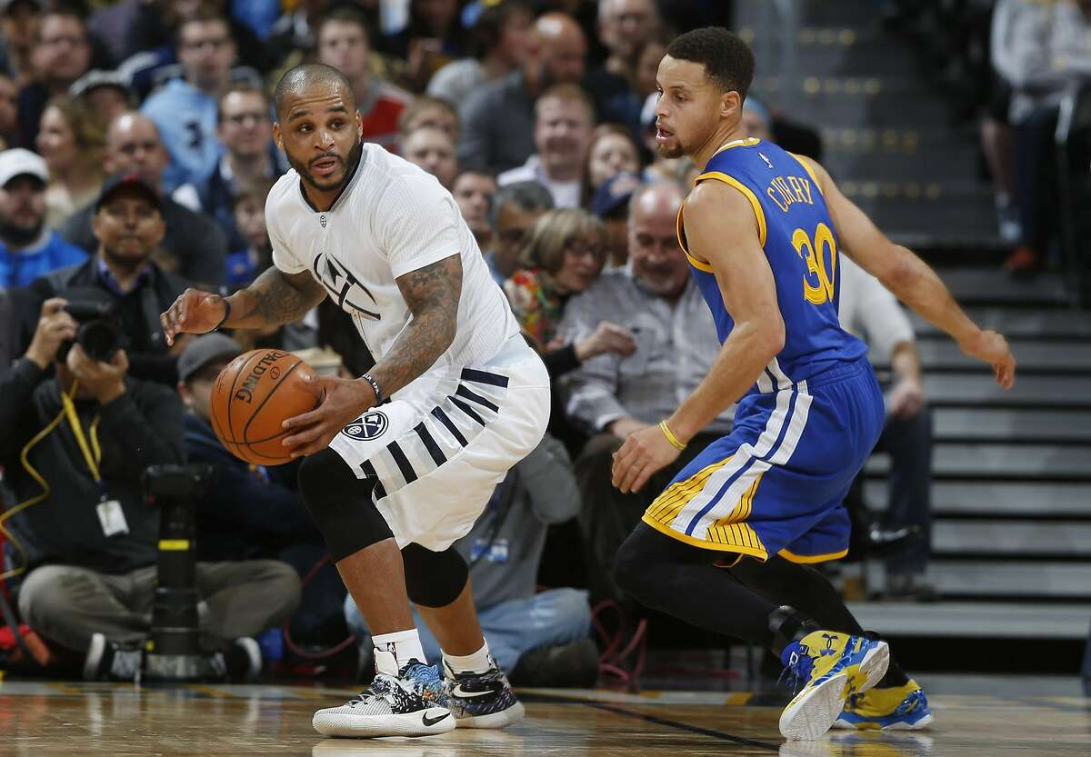 Denver Nuggets guard Jameer Nelson, left picks up a loose ball as Golden State Warriors guard Stephen Curry defends during the first half of an NBA basketball game, Wednesday, Jan. 13, 2016, in Denver.