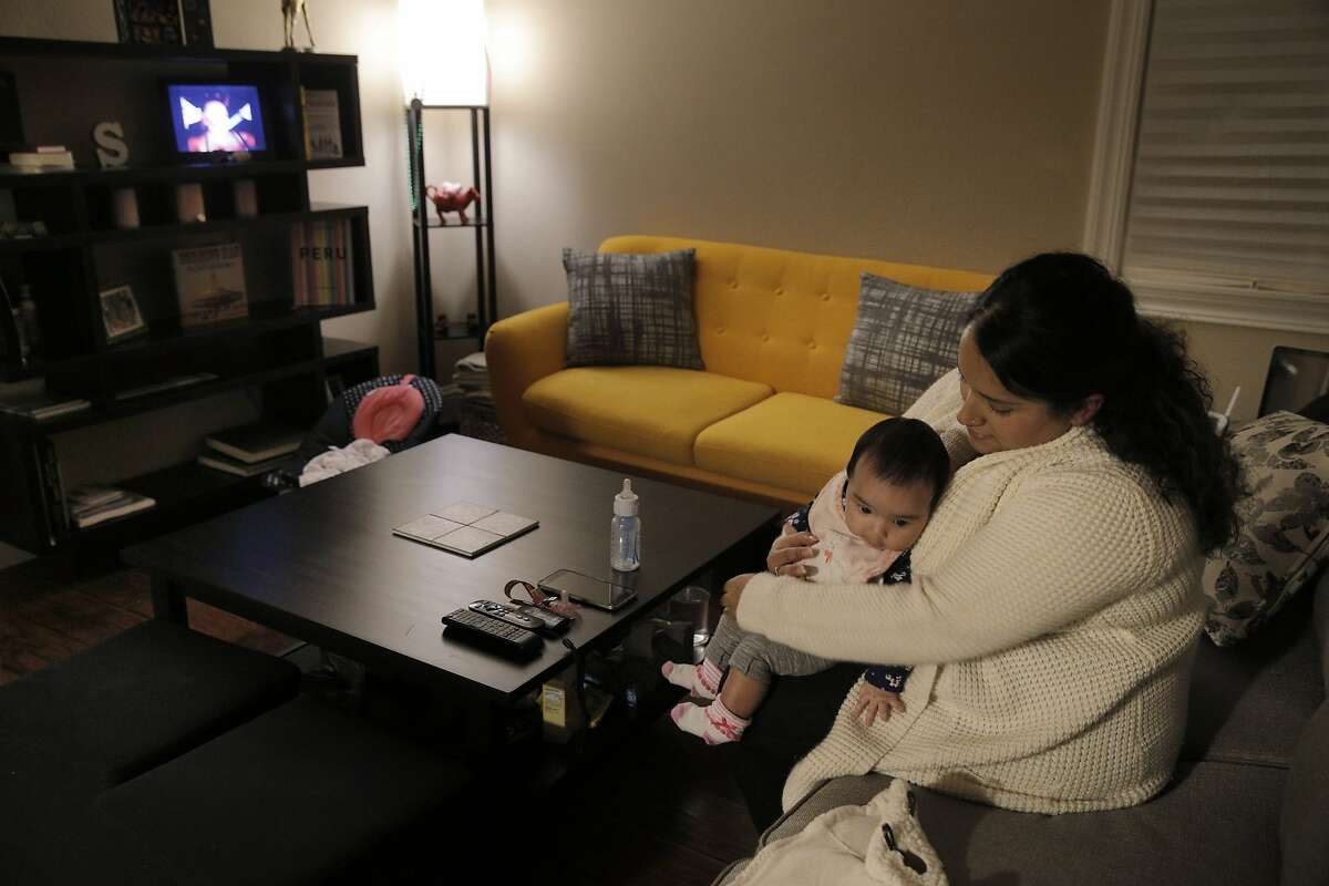 Sylvana Stall-Flores and daughter Sascha Stall-Flores in their home in Oakland, Calif., on Wednesday, January 13, 2016. The Stahl-Flores and her husband, Simon Stahl, recently moved from San Francisco to Oakland where they found buying a house much more affordable. Sascha was born two weeks before they purchased their home.