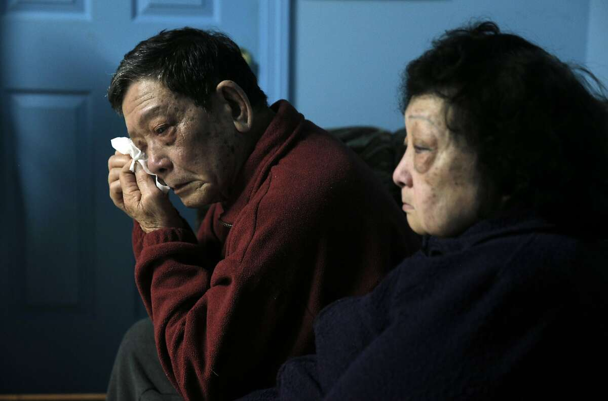 Chien Bui reacts as he and his wife Ai Huynh, remember their son, Vinh Bui in their family home in San Francisco, Calif., on Monday, January 4, 2016. Five years ago, Vinh Bui, who suffered from mental illness, was shot and killed by SFPD after a family member called for assistance. His story is one that matches a narrative that has been seen far too often in San Francisco, including most recently that of Mario Woods.
