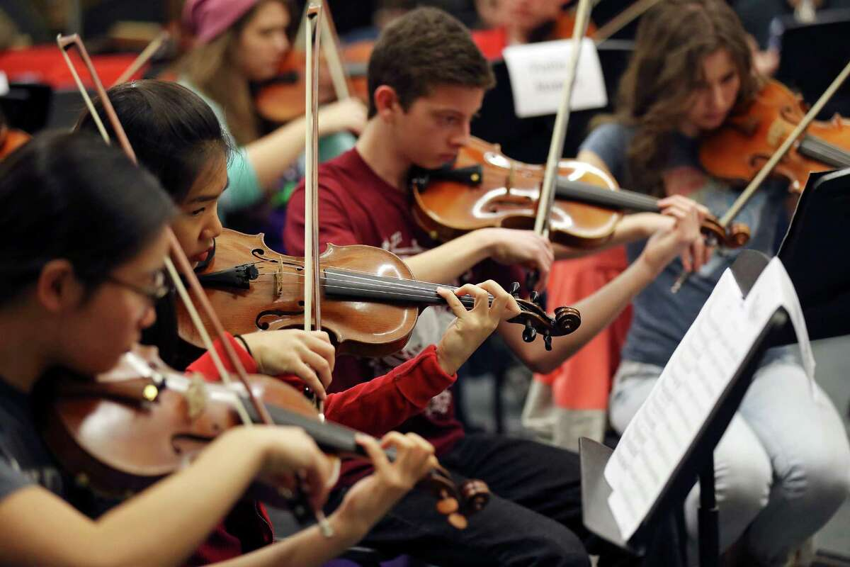 Members of the Youth Orchestras of San Antonio rehearse for the Danzas de las Americas.