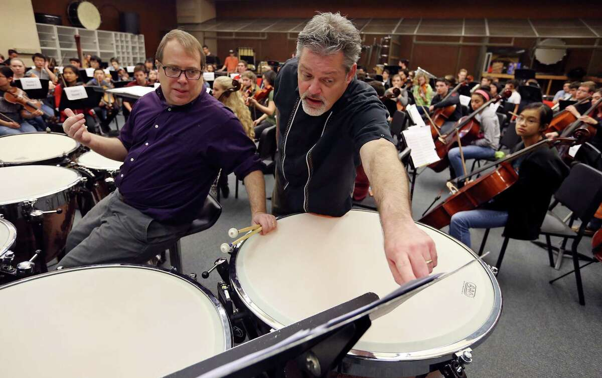 Youth Orchestras of San Antonio Music Director Troy Peters (right) talks with timpanist Peter Flamm, during a rehearsal for YOSA's Danzas de las Americas part of the San Antonio Symphony?•s 2016 Las Americas Festival, Sunday Jan. 11, 2016 at the UTSA Rehearsal Hall. Danzas de las Americas is Jan. 31, 2016, 7 p.m., at the Tobin Center for the Performing Arts.