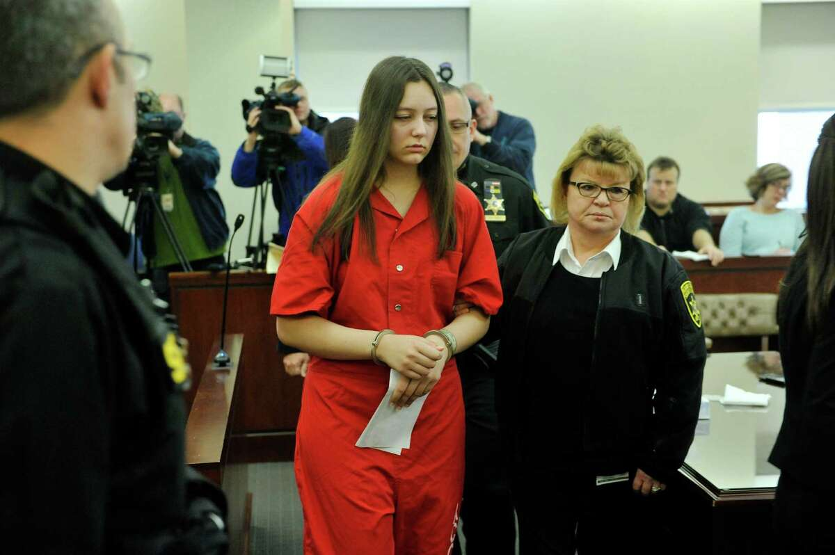 Tiffany VanAlstyne, center, taken out of Albany County Court on Thursday, Jan. 14, 2016, following her sentencing for the killing of Kenneth White. (Paul Buckowski / Times Union)