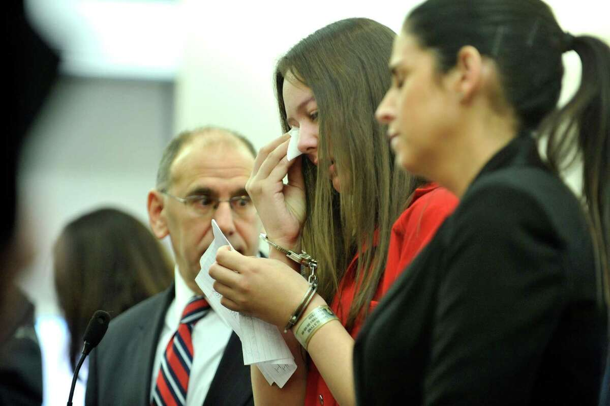 Tiffany VanAlstyne, center, stands with her two attorneys, Albany County public defender James Milstein, left, and Albany County assistant public defender Rylan Richie, in Albany County Court on Thursday, Jan. 14, 2016, during her sentencing for the killing of Kenneth White. (Paul Buckowski / Times Union)