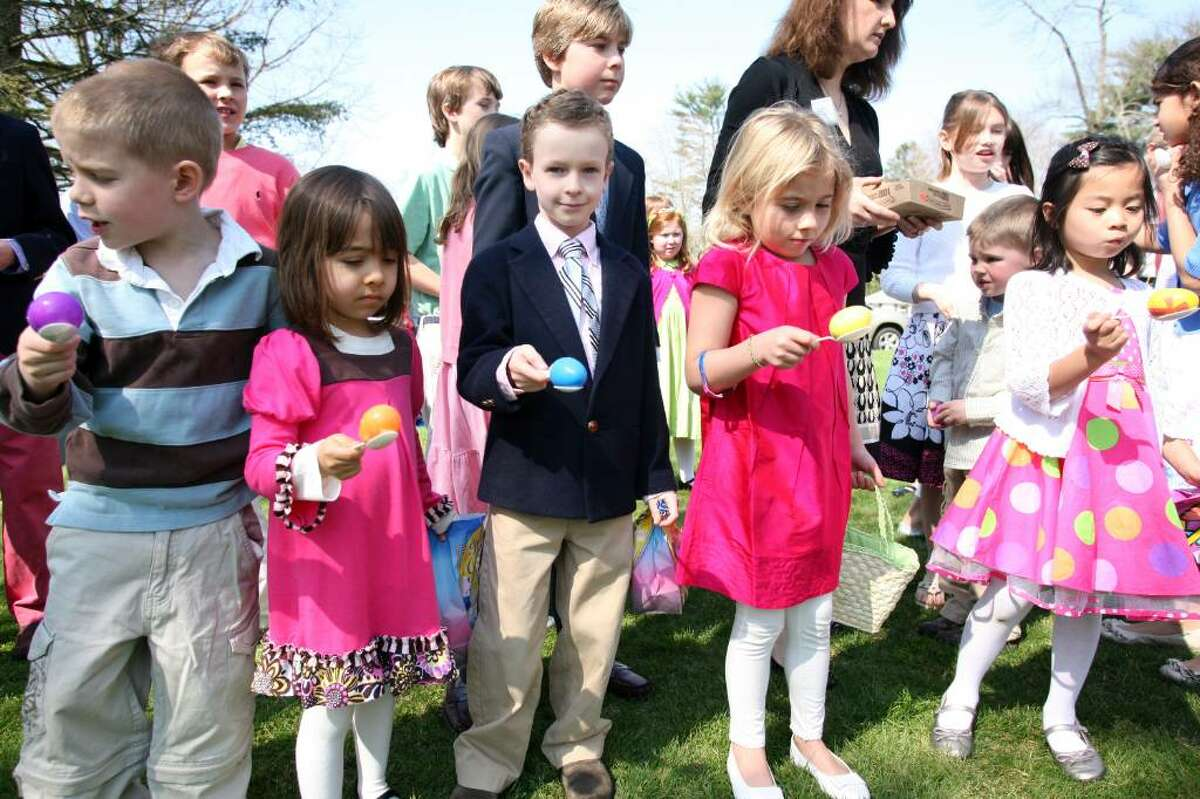 Children from the Second Congregational Church balance their eggs before the start of the egg and spoon race that was held as part of a children's program at the church Sunday morning.