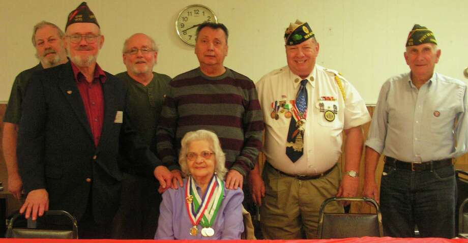 The New Milford VFW recently held a luncheon to honor Jennie (Berry) Rapp, whose son, Robert C. Berry of New Milford, was killed in action in Vietnam in 1966. Rapp was presented her son's New Milford Veterans Medal and the 50th anniversary Vietnam medal. Above, Rapp is joined by, from left to right, Duane Neiman, VFW Commander Jim Delancy, Willilam Shemeley, Frank Peet, American Legion Commander Jeff McBreairty and, John Avalone, all Vietnam veterans. Photo: Courtesy Of VFW / The News-Times Contributed