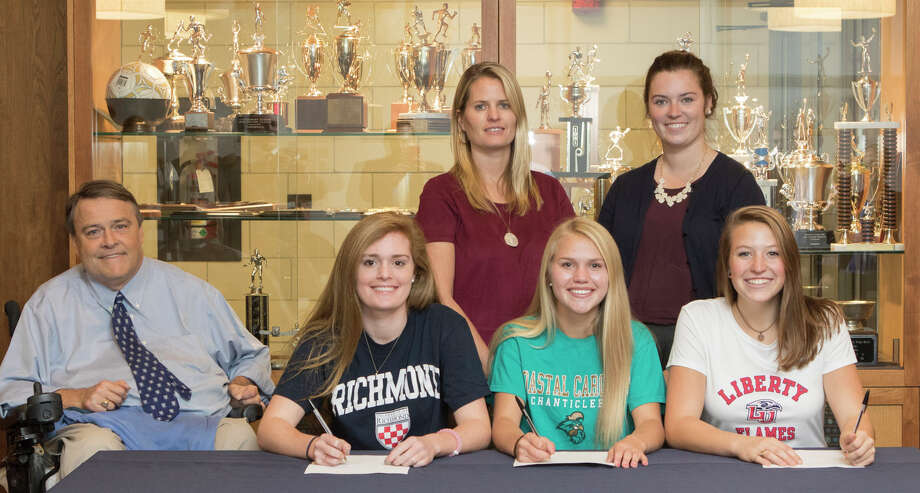 Canterbury School in New Milford has announced Hannah Krin of Roxbury has signed a letter of intent to attend Coastal Carolina University next fall. Above, Hannah, third from left, is shown with, from left to right, coach Frank Bice, student-athletes Maddie Finnen and Jenna Joyal, and in back, girls' varsity lacrosse coaches Lindsey Mulhern and Maeve Carroll. Photo: Courtesy Of Canterbury School / Marc Vanasse
