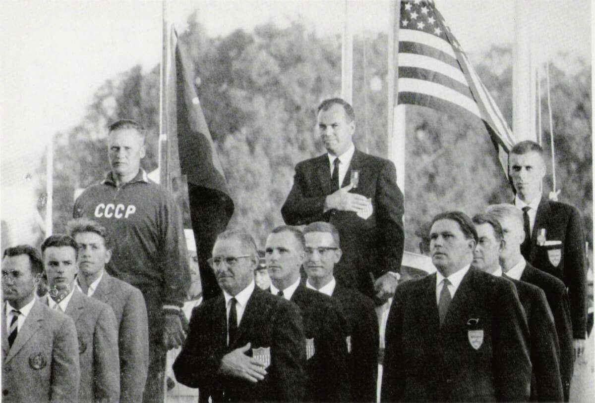 Tom Heffron, second from the front of the middle row, poses with other members of the U.S. International Skeet Team, the Soviet Union?'s team on the left and Sweden?'s on the right after winning the gold medal at the 1962 International Shooting Union World Championship in Cairo, Egypt.