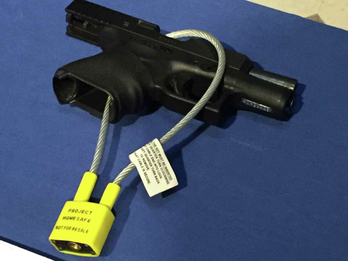 Albany police are distributing free gun locks like this one at every police station to promote awareness of a new city law, which went into effect Jan. 1, 2016, that requires all firearms at home be stored securely. (Jordan Carleo-Evangelist/Times Union)
