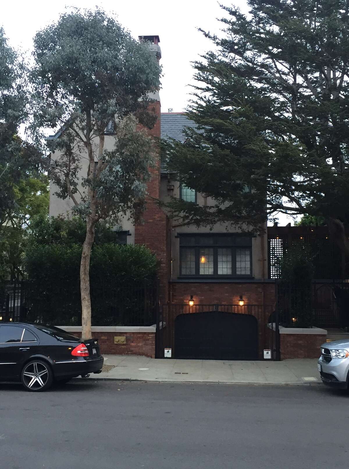 The driveway to Mark Zuckerberg's $10 million house in San Francisco's Mission District sits empty while his security detail's SUV's take up