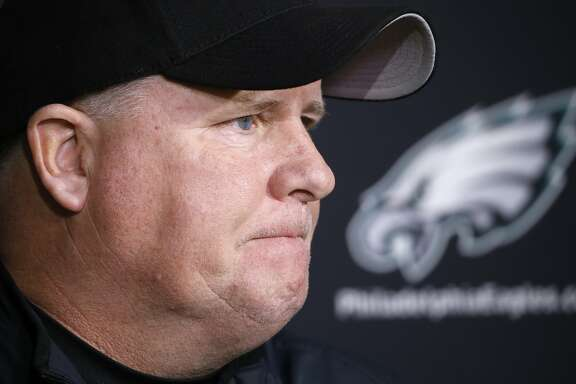 In this Monday, Dec. 28, 2015 photo, Philadelphia Eagles head coach Chip Kelly listens to a question during a news conference at the NFL football team's practice facility in Philadelphia. The Eagles fired Kelly with one game left in his third season, dumping the coach after missing the playoffs in consecutive years. Kelly was released Tuesday, Dec. 29, 2015 just before the end of a disappointing season that began with Super Bowl expectations. (AP Photo/Matt Rourke)