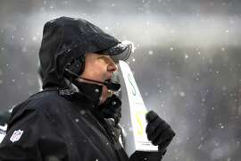 Philadelphia Eagles head coach Chip Kelly is seen during the second half of an NFL football game, Sunday, Dec. 8, 2013, in Philadelphia. (AP Photo/Michael Perez)