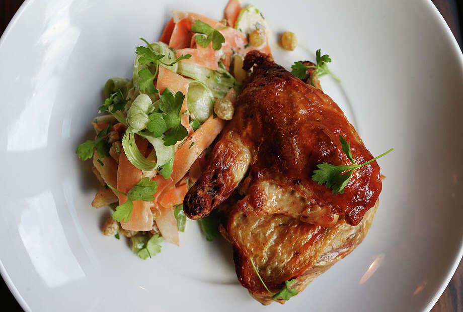Pollo asado (roasted chicken)  with a salpicão Photo: Jerry Lara /San Antonio Express-News / © 2016 San Antonio Express-News
