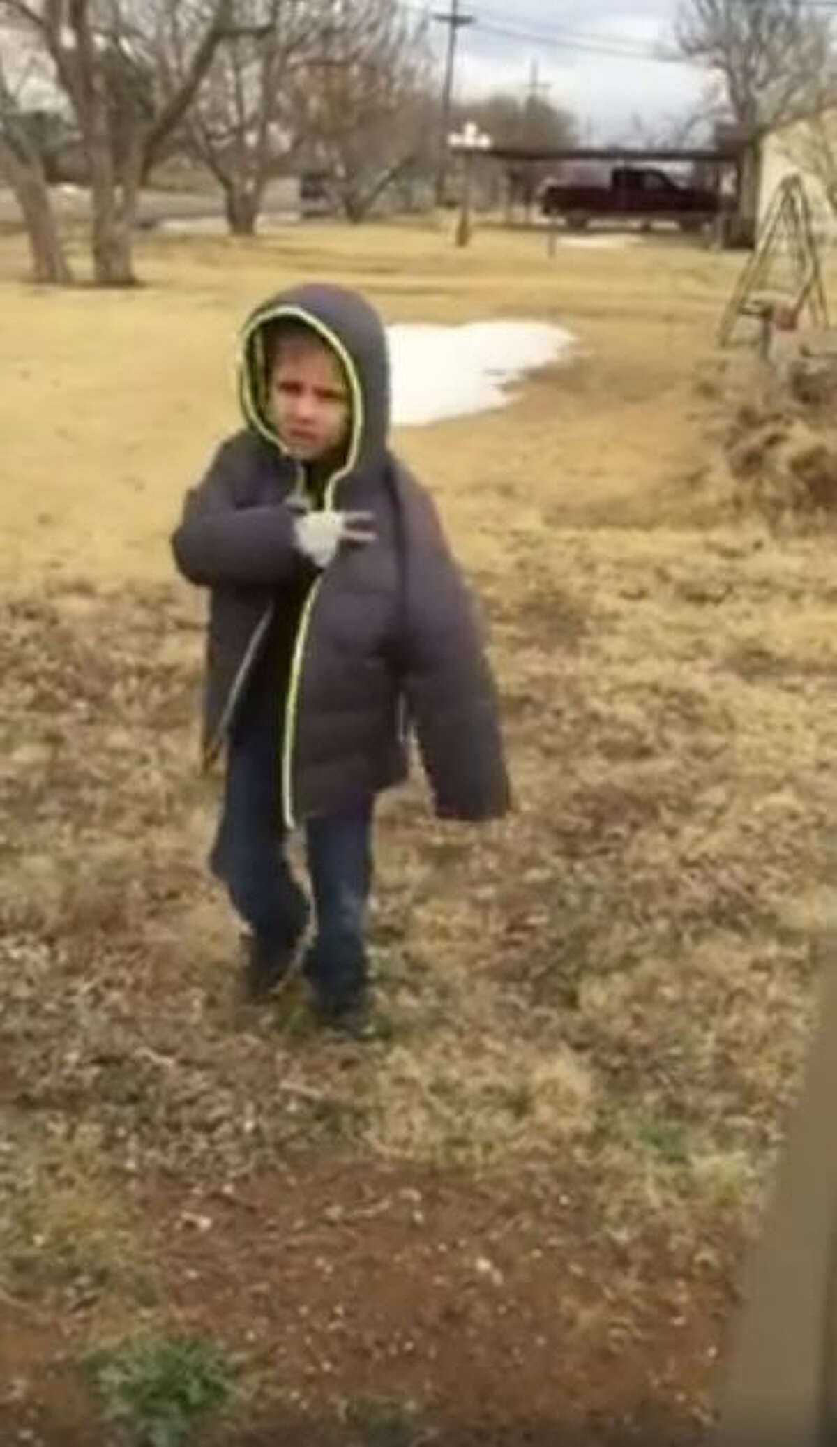 Heartwarming viral video out of Lubbock shows the emotional reunification of a young boy and his lost puppy. Image credit: Paula Williams via Facebook