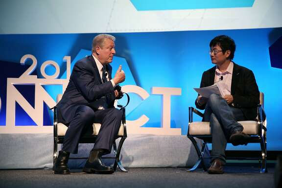 "Former Vice President Al Gore (l to r) and Sheng Fu, CEO Cheetah Mobile, talk during a  ""fireside chat"" at  Connect 2016 on Thursday, January 14, 2015 in San Francisco, Calif."