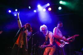 (l-r) Charles Darius, Lloyd, and Adam Dragland perform with their band the Church of the Sacred Silversexual, as part of a David Bowie tribute concert, at Slim's in San Francisco, California on Wednesday, January 13, 2016.