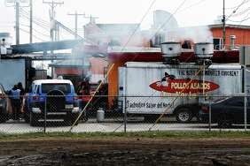 Smoke emanates from a portable cook stand as well as from an affixed building at Pollos Asados Los Nortenos restaurant on Rigsby Avenue on Thursday, Jan. 14, 2016. Some neighbors have complained about the large quantities of smoke that spills into the nearby neighborhood which they believe are causing respiratory issues for people in the area.