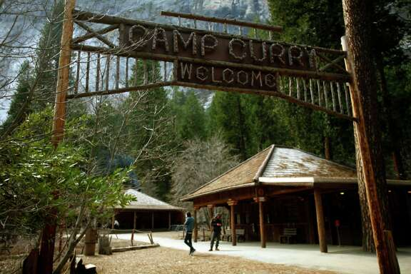 The historic wood sign at Camp Curry still greets visitors arriving at the famous lodging site in Yosemite March 26, 2013. Construction and mitigation measures are progressing at Camp Curry, a year after hantavirus sickened and killed several visitors staying in some of the signature tent cabins